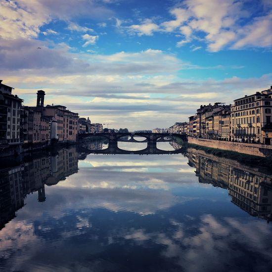 A river of clouds Ponte Vecchio Water Sky Cloud - Sky Reflection Architecture Built Structure Connection River Bridge Travel Destinations City Arch Bridge