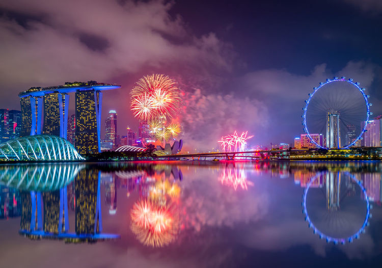 Marina Bay Sands Singapore Flyer Architecture Arts Culture And Entertainment Building Exterior Built Structure Celebration Ferris Wheel Illuminated Long Exposure Multi Colored Night No People Outdoors Reflection Sky Water Waterfront
