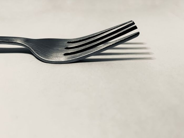 White Background Studio Shot Single Object Still Life Metal Close-up Indoors  No People Table Kitchen Utensil High Angle View Copy Space Eating Utensil Stainless Steel  Fork Steel Silver Colored Household Equipment Shadow