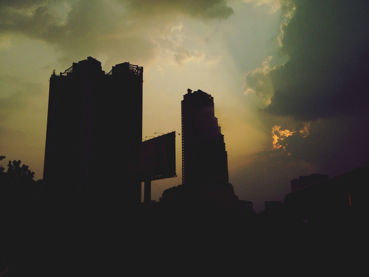 architecture, built structure, sunset, skyscraper, sky, building exterior, silhouette, city, cloud - sky, no people, outdoors, travel destinations, smoke stack, modern, factory, cityscape, day