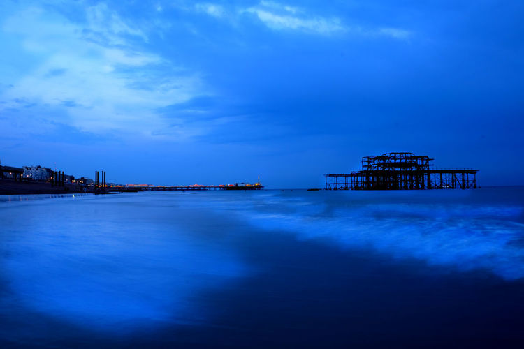 Architecture Beauty In Nature Blue Brighton Brighton Beach Brighton Pier Brighton Pier UK Building Exterior Built Structure Cloud - Sky Day Derelict Building Dusk In The City Nature No People Outdoors Pier Scenics Sea Sky Tranquil Scene Tranquility Water Waterfront