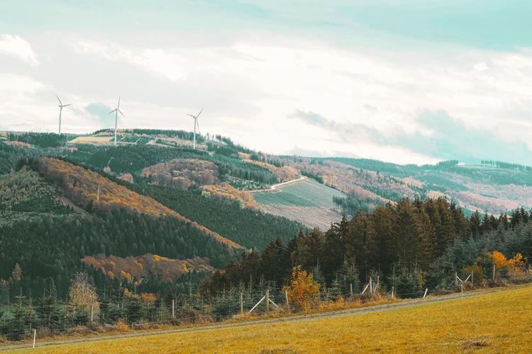 Sauerland hochsauerlandkreis nrw germany landscape with mountains, hills, wind tribunes and grass