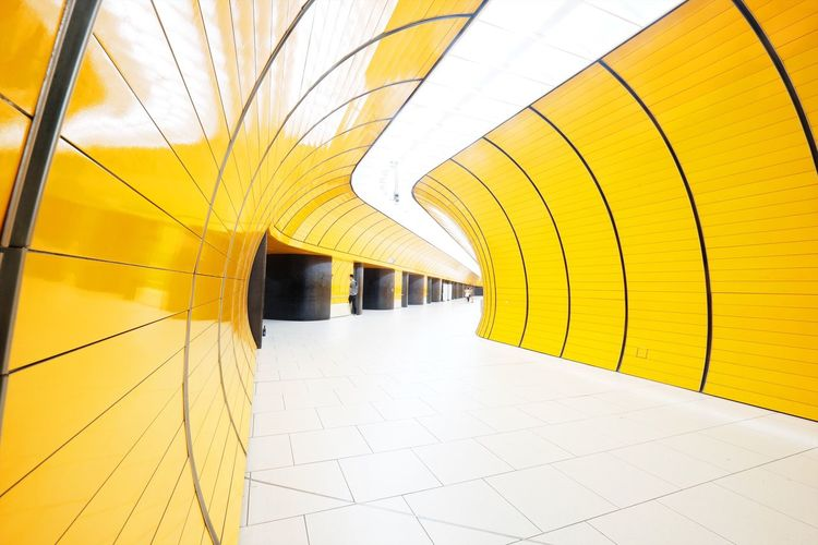 Architecture Modern Indoors  Corridor Yellow Built Structure Arch Ceiling Tunnel Tiled Floor Railroad Station Transportation Illuminated No People Multi Colored Subway Train Day City Futuristic Colors Orange Underground