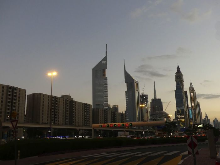 Sheik Zayed Road in the Early Evening, Dubai, United Arab Emirates 2019 Dubai UAE 2019 Sheik Zayed Road Blue Sky Evening Sky City Illuminated Urban Skyline Night No People Transportation Modern Cityscape Tall - High Towers Skyscrapers Architecture Skyline Traffic Signals Composition Outdoor Photography Night Photography Tourist Destination Travel