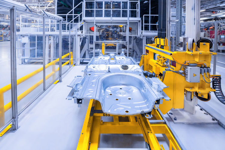 High angle view of yellow machinery in factory