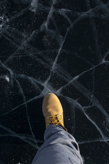 Low section of man standing on marble