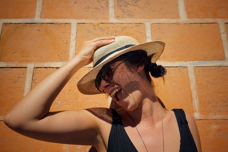 Another laugh in the World Smiling Beautiful Woman Young Women Women Portrait Headshot Human Face Happiness Beauty Skin Care City Sun Hat A New Beginning International Women's Day 2019