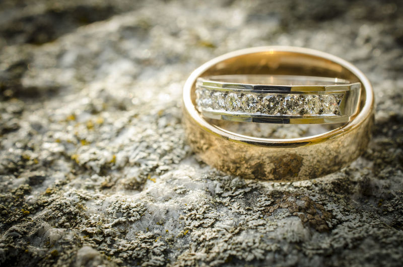 Wedding And Engagement Rings On Rock