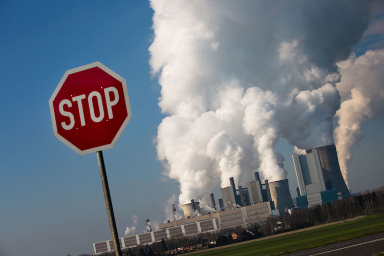 Cole power plant in Niederaussem, North Rhine-Westphalia, Germany Air Pollution Blue Sky Break Up Cloud Cloudy CO2 Emissions Coal Power Plant Coal Power Plant Electricity  Energie Fog Fossil Energy Industrie Low Angle View Outdoors Power Plant Road Sign Sign Sky Smoke Steam Stop Stopsign Symbolic