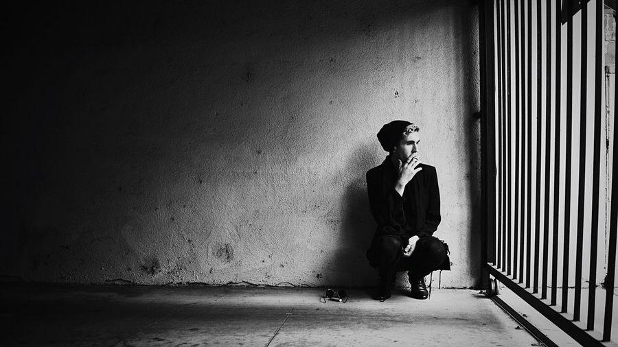 Man smoking cigarette in prison