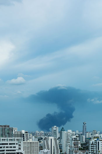 Huge explosion and fire at plastic factory on outskirts of town, environmental pollution concept