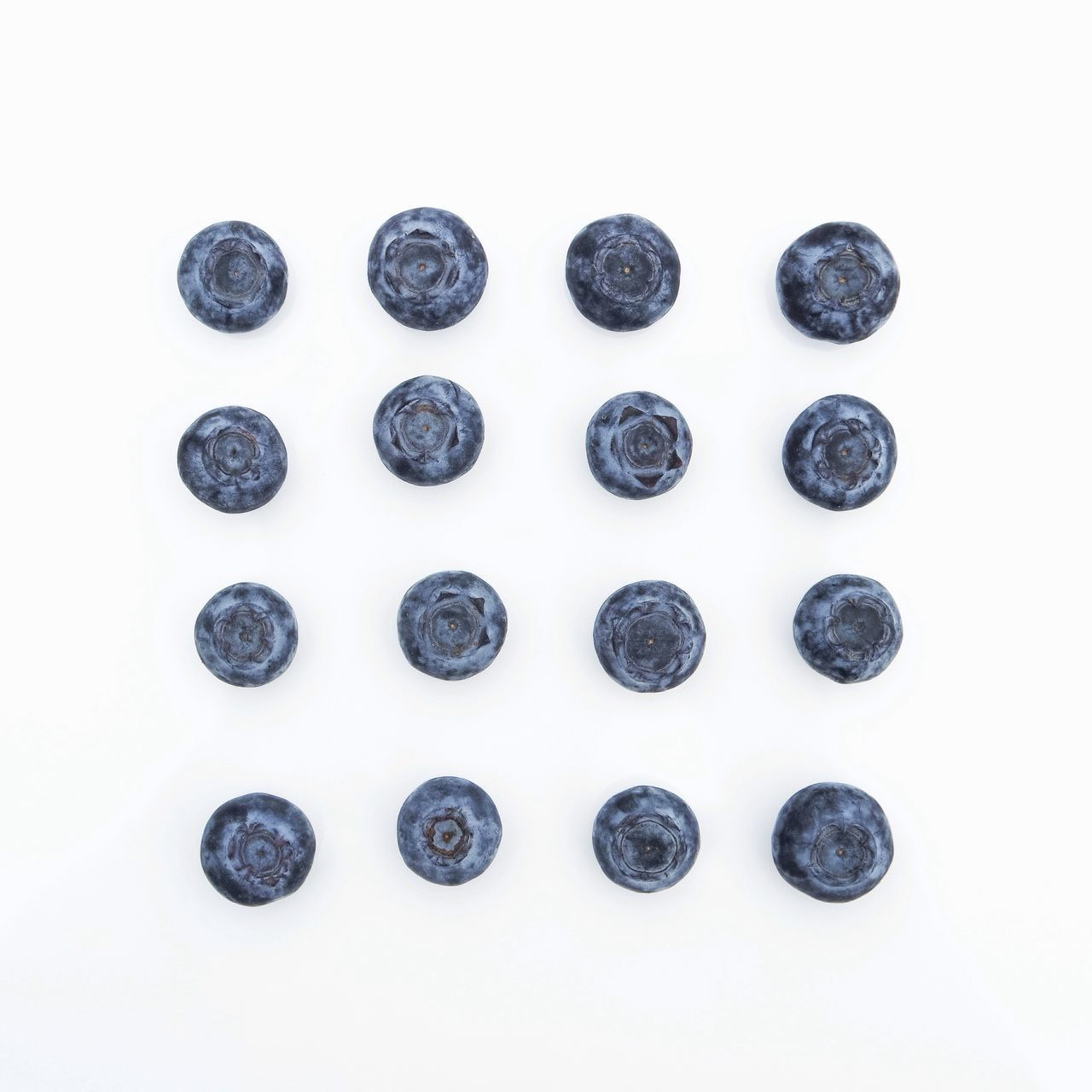 Close-up of blueberries on white background