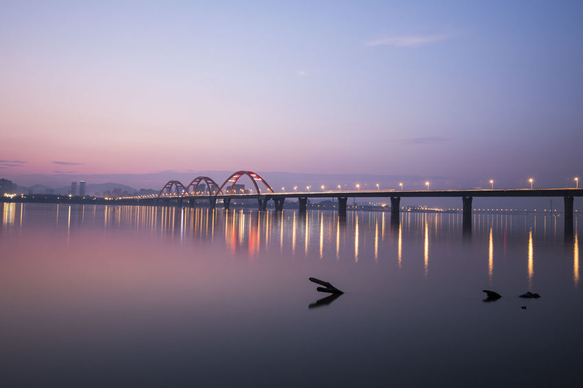 bridge Architecture Beauty In Nature Bird Bridge - Man Made Structure Built Structure Day Dusk Illuminated Nature No People Outdoors Reflection Scenics Sky Sunset Swan Water Waterfront