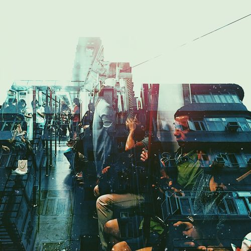 Double Exposure Hong Kong Architecture Building Exterior Built Structure City Clear Sky Crowd Day Large Group Of People Men Outdoors People Real People Riot Sky Streetphotography Transportation