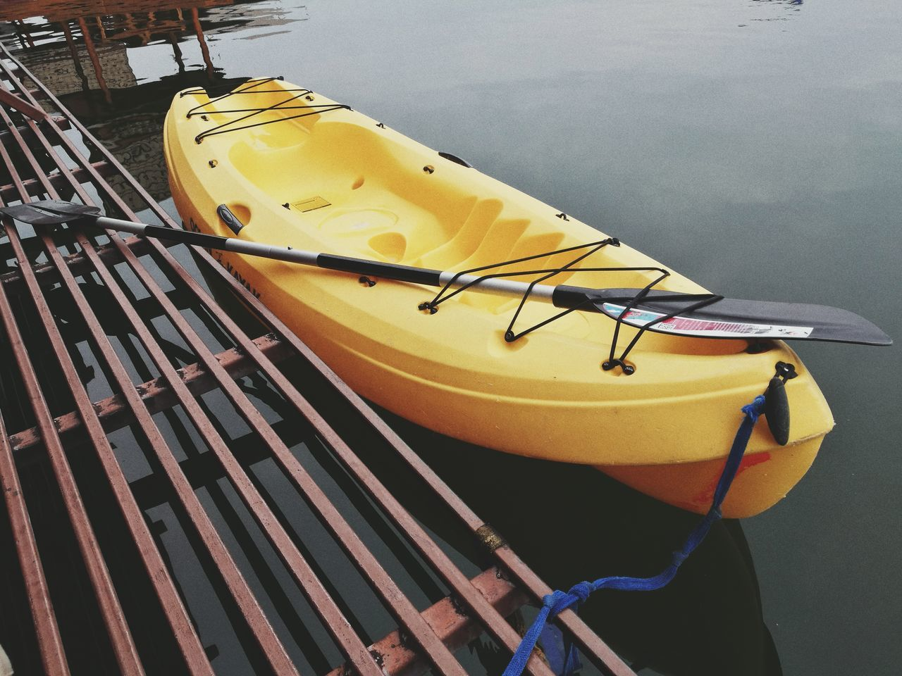nautical vessel, yellow, moored, kayak, transportation, oar, outdoors, day, mode of transport, pedal boat, no people, close-up