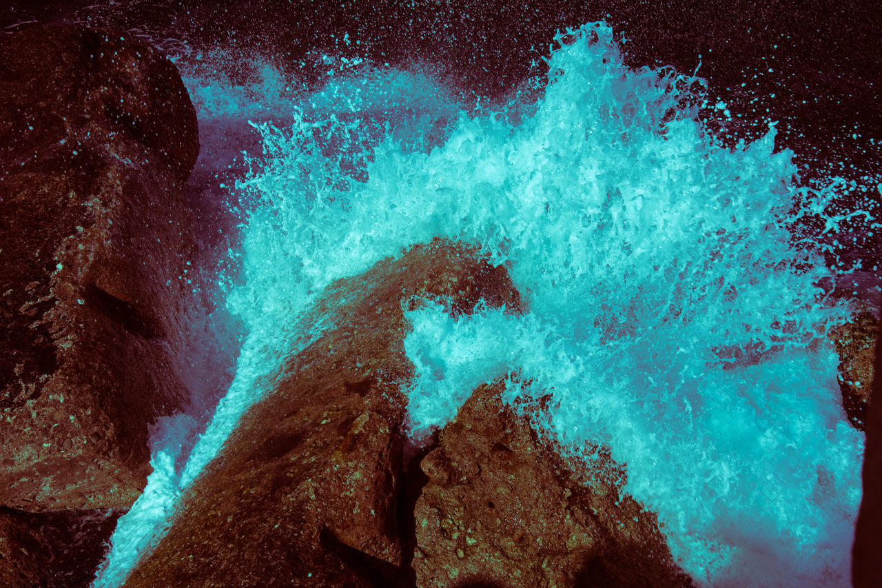 water, sea, motion, rock, nature, rock - object, no people, underwater, beauty in nature, solid, splashing, outdoors, abstract, close-up, undersea, rock formation, tranquility, blue, power in nature
