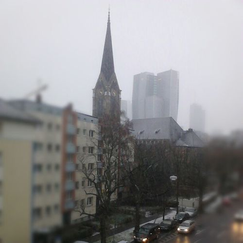 It's snowing again now in #Frankfurt. View out of office. St. Peter-church and #Jumeirah building. Frankfurt Jumeirah
