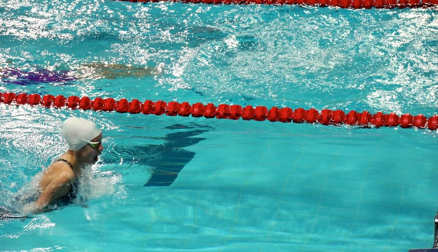 Side view of a swimmer in water