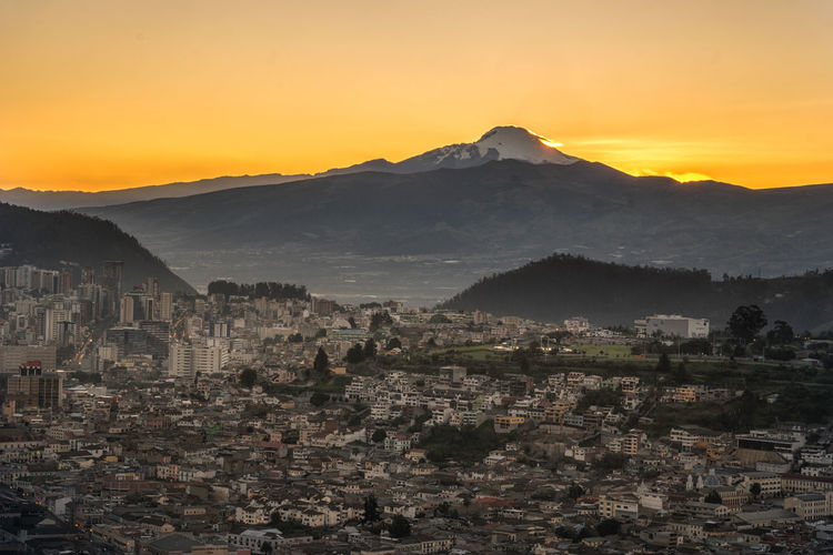 Quito cityscape and the Cayambe volcano just before sunrise Cayambe City Cityscape Ecuador Landscape Mountains Nature Quito Sunrise Urban Landscape Volcano The Great Outdoors - 2017 EyeEm Awards Mountain Range Beauty In Nature Mountain South America Tranquility No People Outdoors Scenics Travel Destinations This Is Latin America