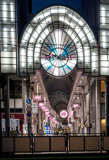 Illuminated Architecture Indoors  Built Structure Glass - Material Lighting Equipment Ceiling Shopping Mall Incidental People Glass Transportation Real People Men Travel People Shopping Business Mode Of Transportation Modern