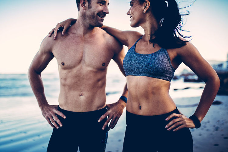 Abs Beach Caucasian Couple Fitness Fitness Couple Fitness Training Fitnessmodel Fitnessmotivation Happiness Lifestyles Muscle Muscular Build Outdoors Shirtless Smile Sport Sports Clothing Standing Summer Together Togetherness Two People Vacations Workout