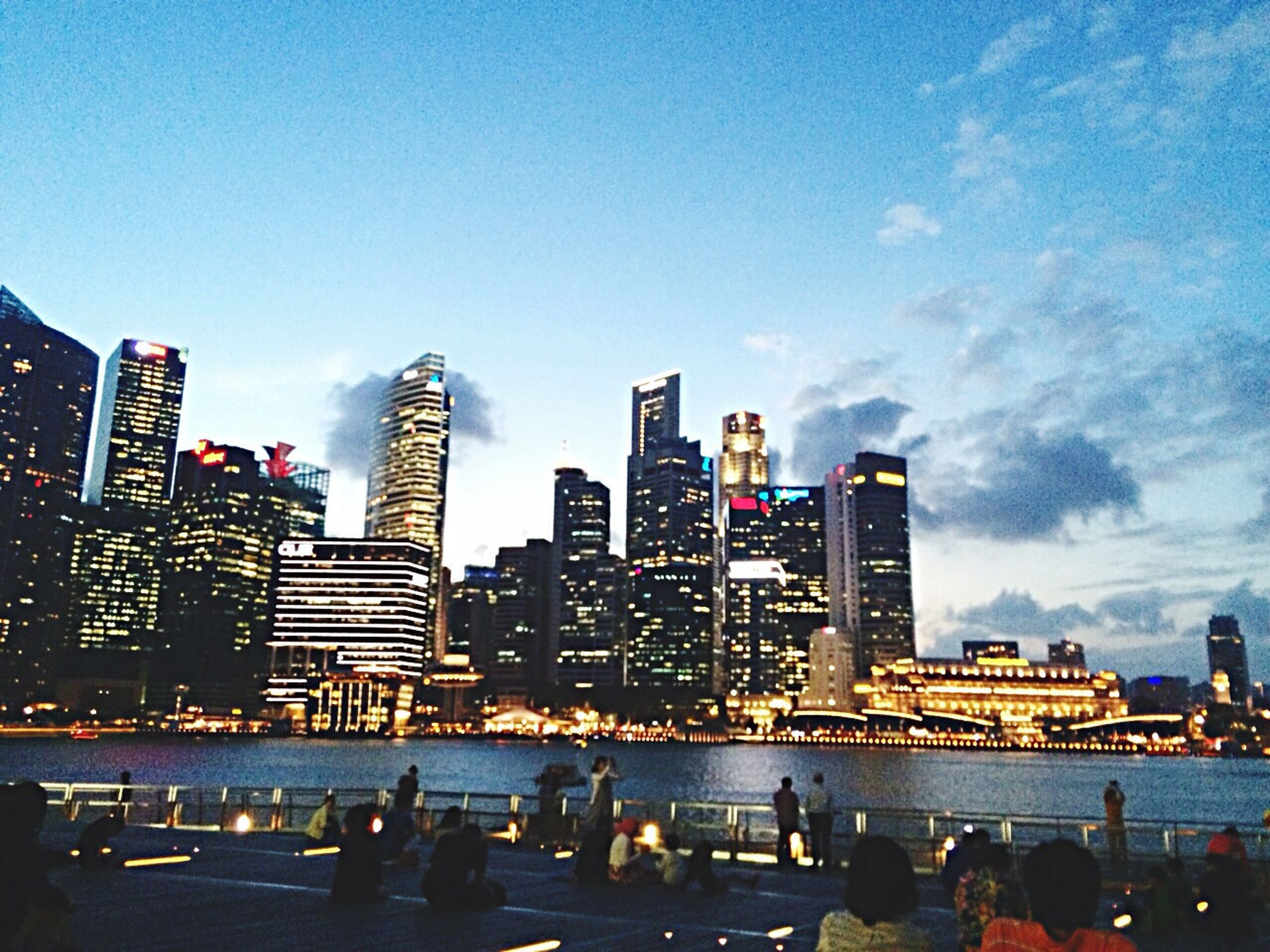 city, building exterior, skyscraper, architecture, built structure, cityscape, urban skyline, tall - high, modern, office building, tower, financial district, water, sky, skyline, city life, tall, capital cities, blue, downtown district