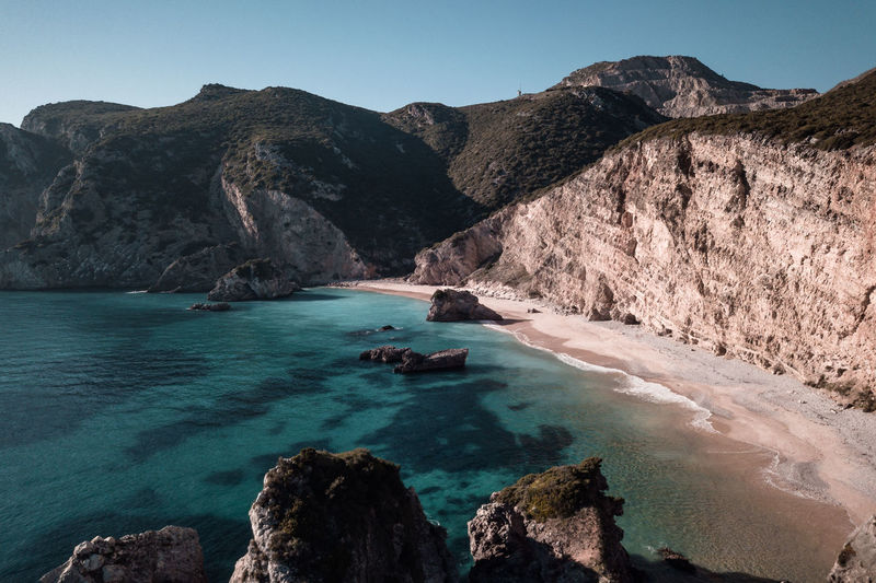 Sea Water Beach Rock Nature Blue Europe Tranquility Coastline Travel Destination Outdoors Geology Sand Tourism Landscape Day Summer Scenics Paradise Hot Land Turquoise Aerial View Arrabida