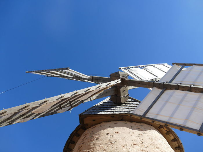 France Aveyron La Couvertoirade Windmill Blue Sky Clear Sky Detail Low Angle View Idyllic Historic Corn Mill White Wings White Color Touristic Attraction Tourism No People