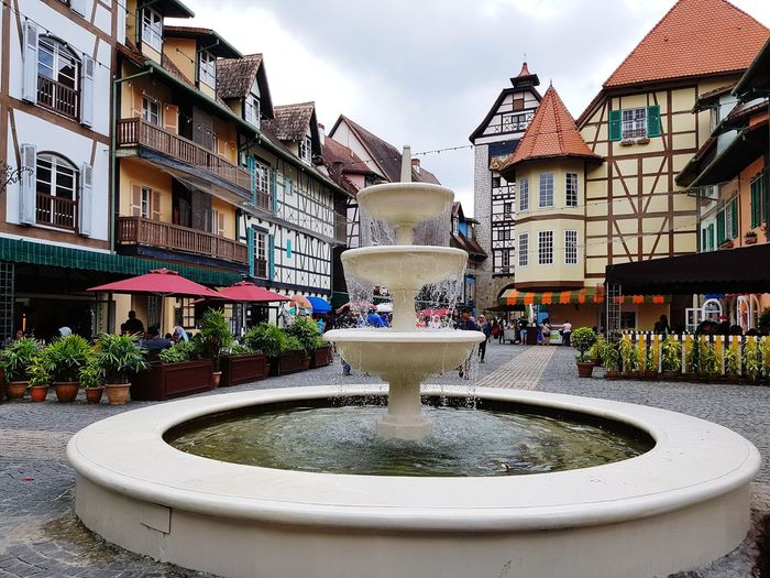 View around Colmar Tropicale, Bukit Tinggi, Pahang, Malaysia. Square Travel Tourism Water Fountain Architecture Building Exterior Sky Built Structure