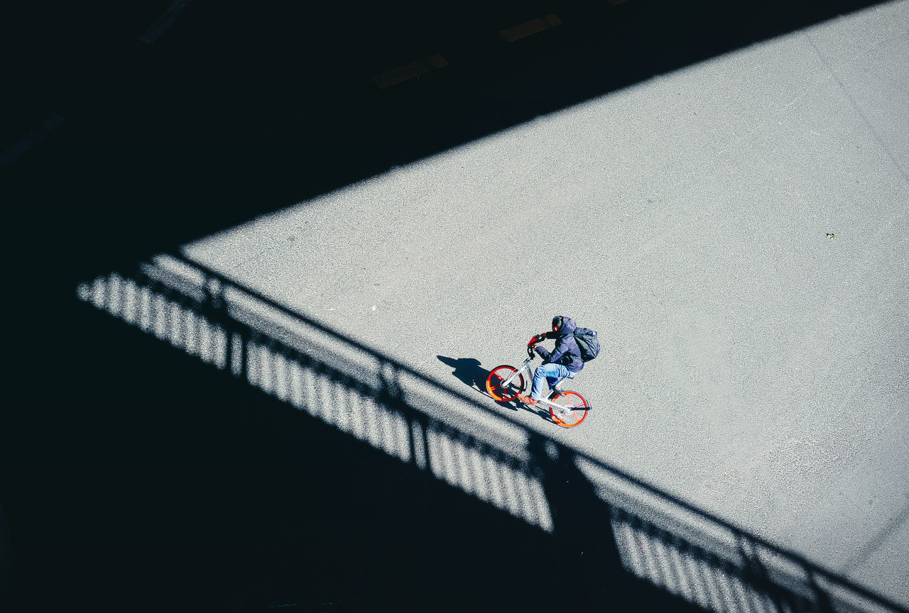 High angle view of man on bicycle