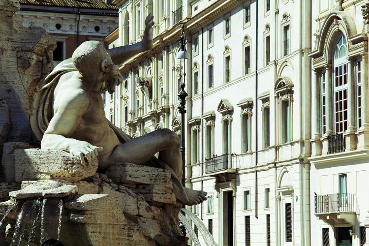 Ancient Architecture Art And Craft Building Exterior Built Structure City City Day Human Representation Low Angle View Mammal No People Outdoors Religion Rome Sculpture Statue Statue Travel Travel Destinations