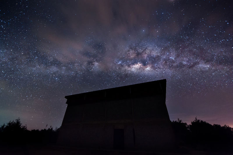 Milky way at Kudat, Malaysia. Nikon D700 nikkor 14-24mm iso 3200/f2.8/20-30 sec Architecture Astronomy Astronomy Telescope Built Structure Constellation Galaxy Low Angle View Milky Way Nature Night No People Outdoors Research Science Sky Space Space Exploration Star - Space Star Field Tree