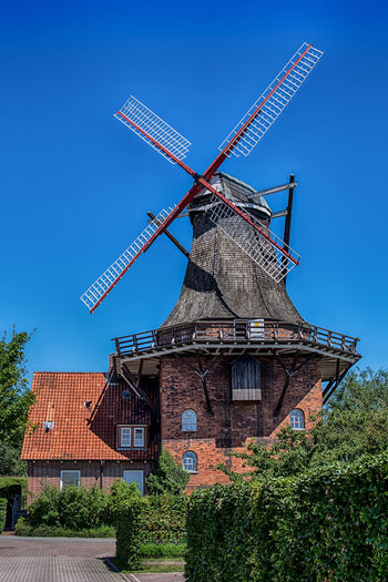 One in a mill-ion. Mill Windmill Outdoors Traditional Windmill No People Clear Sky Travel Photography Travelling Germany HDR Architecture Architecture_collection Europe Multi Colored Town TOWNSCAPE Colourful Blue Sky Wind Power Alternative Energy Jork Building Exterior Rural Scene Deutschland House
