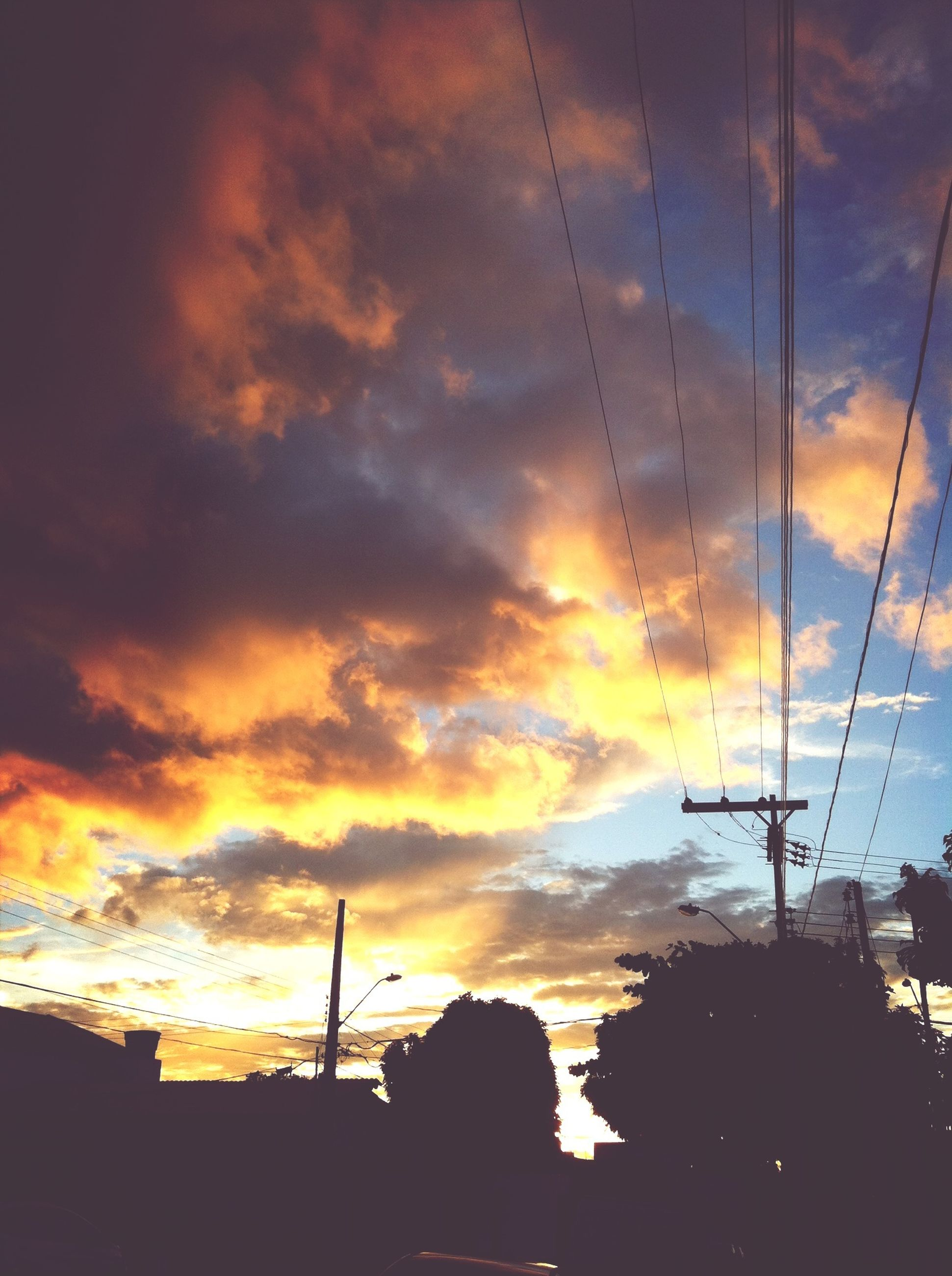 sunset, sky, orange color, cloud - sky, silhouette, architecture, built structure, building exterior, low angle view, cloudy, power line, cloud, dramatic sky, electricity pylon, beauty in nature, street light, nature, outdoors, scenics, no people