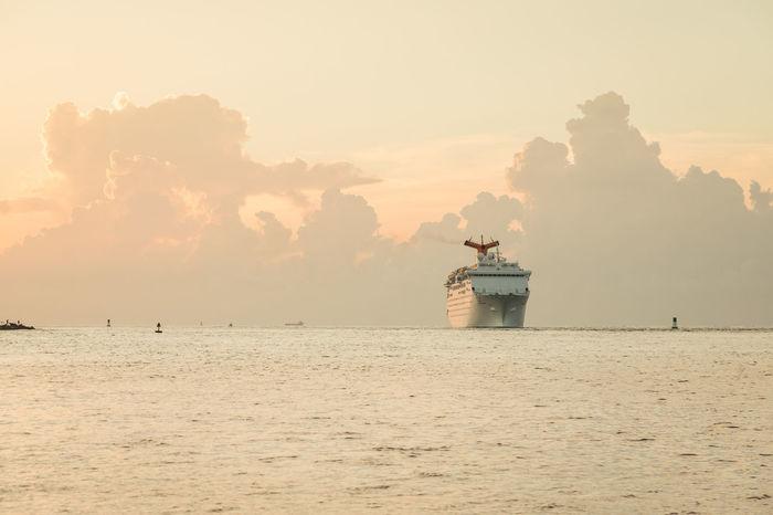 Cruise ship leaving port in Palm Beach, Florida. Atlantic Atlantic Ocean Cruise Ship Harbor Harbour Atlantic Coast Florida Mode Of Transportation Nautical Vessel No People Outdoors Palm Beach Sea Ship Sky Sunrise Transportation Water