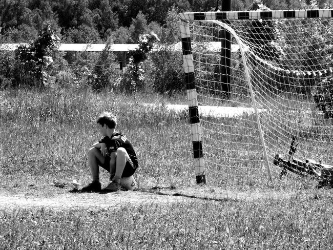 Ball Blackandwhite Boys Bycicle Childhood Day Football Full Length Grass Leisure Activity Lifestyles Nature One Boy Only One Person Outdoors People Playing Real People Sitting Sport Summer Tree Unrecognizable Person Be. Ready. Black And White Friday