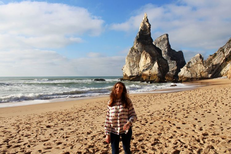 Sea Land Water Beach Sky Beauty In Nature Leisure Activity Real People Standing Scenics - Nature Nature Lifestyles Cloud - Sky Casual Clothing Rock Women Rear View One Person Horizon Over Water Outdoors Hairstyle Praia Da Ursa Happiness