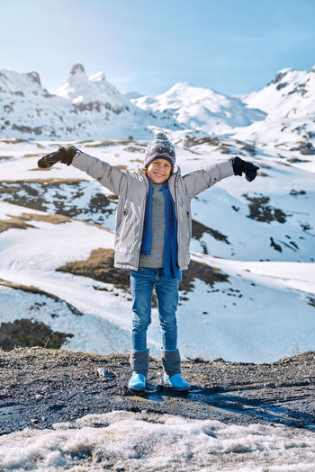 Full length of man standing on snow