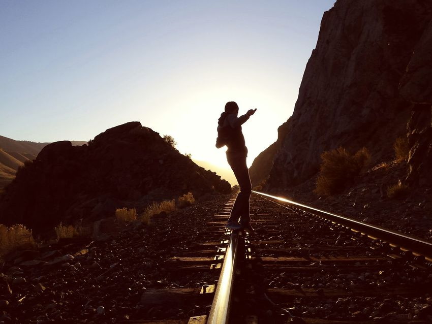 Taking the rails to nowhere in particular. Silhouette Adventure One Man Only Full Length One Person Outdoors The Way Forward Nature Young Adult Extreme Sports Day RISK Exploring Skill  Balance Railroad Track Tracks Railroad An Eye For Travel Transportation Leisure Activity Standing People Love Yourself