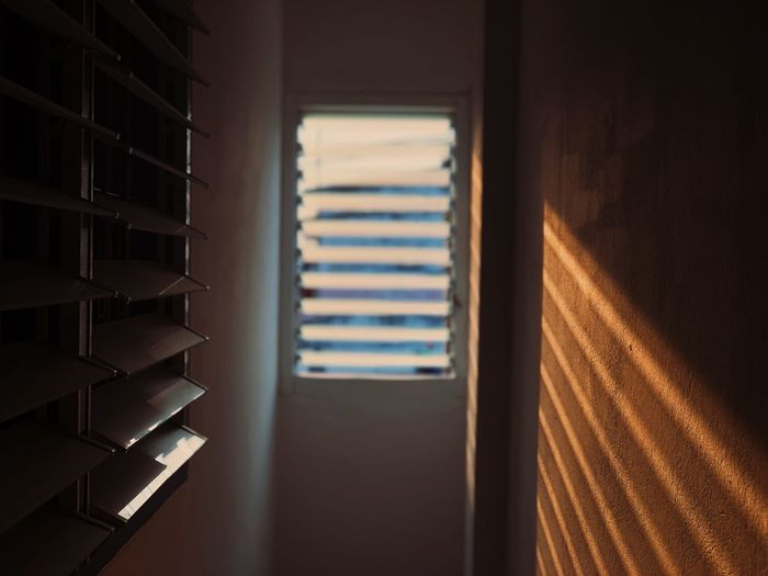 View of sunlight coming through window on wall