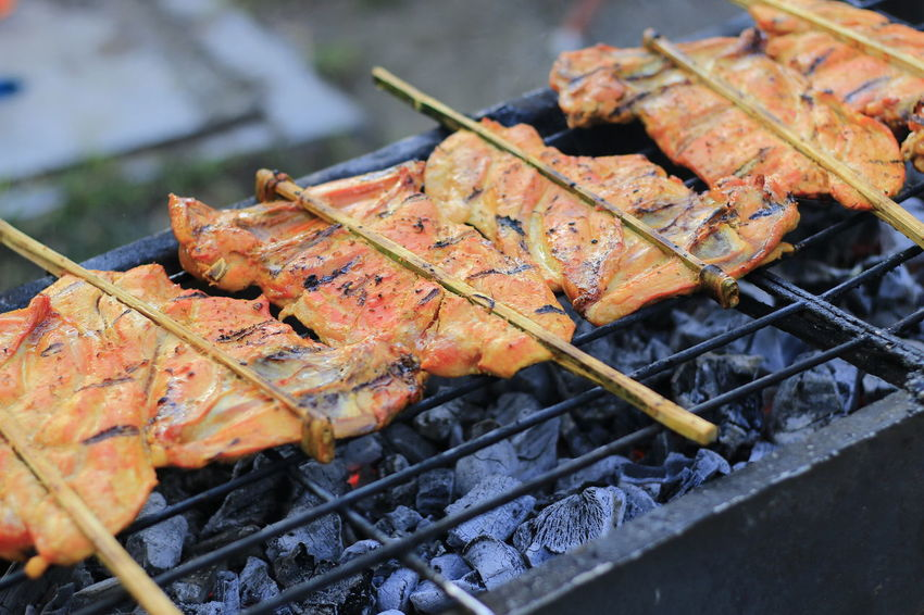 Grilled Chicken Grilled Chicken .Thailand Food Style Barbecue Meat Food Grilled Food And Drink Barbecue Grill Heat - Temperature Skewer High Angle View No People Preparation  Metal Close-up Freshness Day Focus On Foreground Outdoors Grid Preparing Food Healthy Eating Temptation Snack