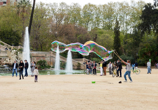 People enjoy the soap bubbles in the in the Ciutadella Park in Barcelona. Ciutadella park is one of the finest parks in Barcelona. Park dotted with historic landmarks, statues and fountains Barcelona, Spain Catalonia Childhood Children City Ciutadella Park Crowd Of People Day Entertainment Europe Famous Place Fountain Fun Human Landmark Motion People Show Soap Bubbles SPAIN Spring Tourist Tourist Attraction  Travel Destinations Youth