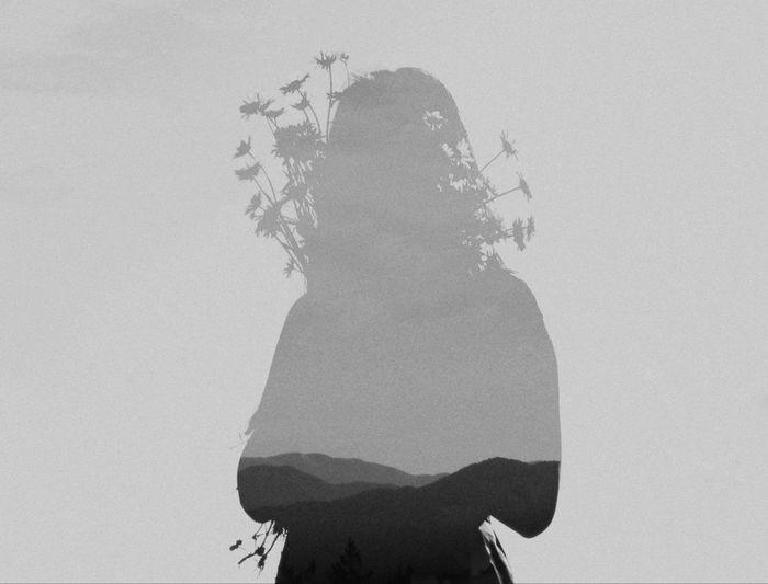Portrait of silhouette woman standing against sky
