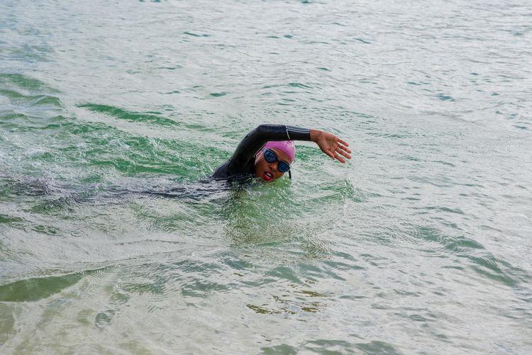 Portrait of person swimming in sea