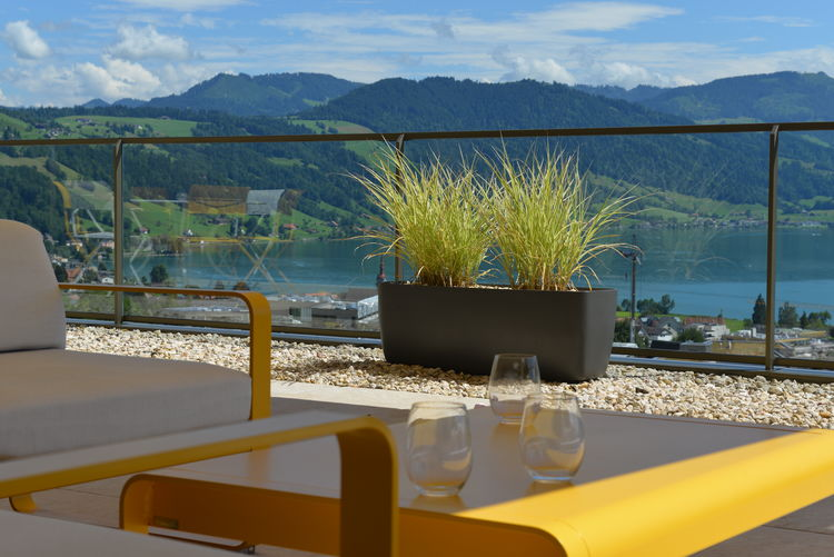 Beauty In Nature Chair Day Food And Drink Glass Glass - Material Luxury Mountain Mountain Range Nature No People Outdoors Plant Railing Scenics - Nature Sea Seat Sky Table Water