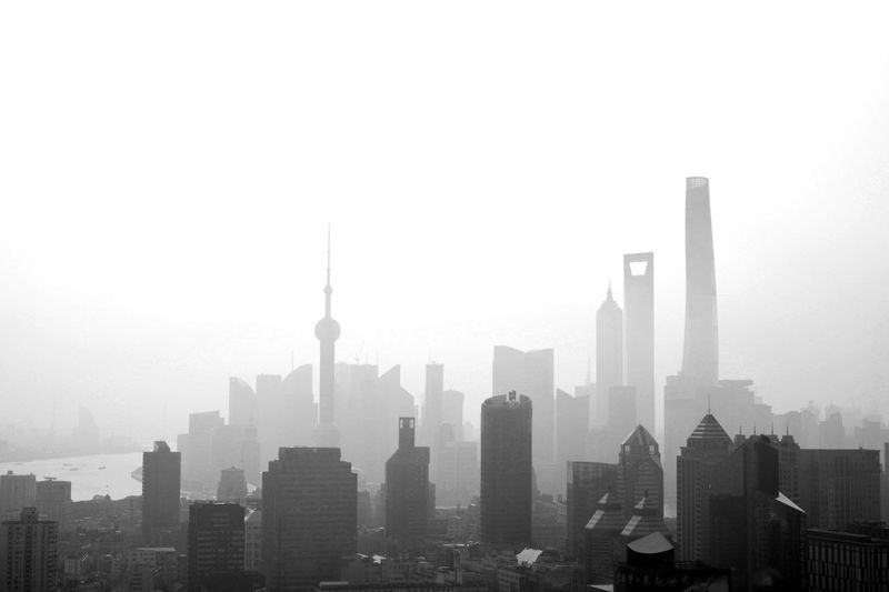 Cityscape Against Sky During Foggy Weather