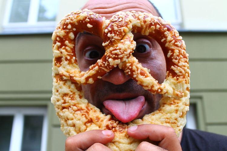 Close-up of man holding pretzel