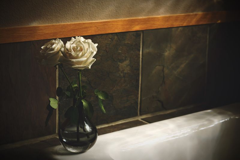 White roses in vase on table