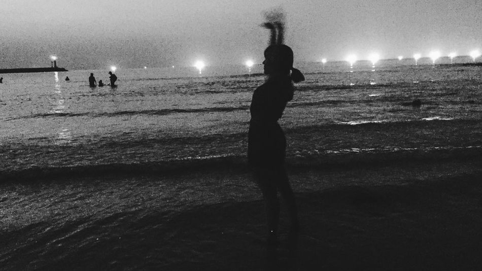 Girl at the beach Beach Real People Water Sea Shore Standing Sand Silhouette Leisure Activity Full Length Lifestyles Night Men Nature Outdoors Sky Women Vacations Wave Illuminated Blackandwhite Blackandwhite Photography Black And White Friday