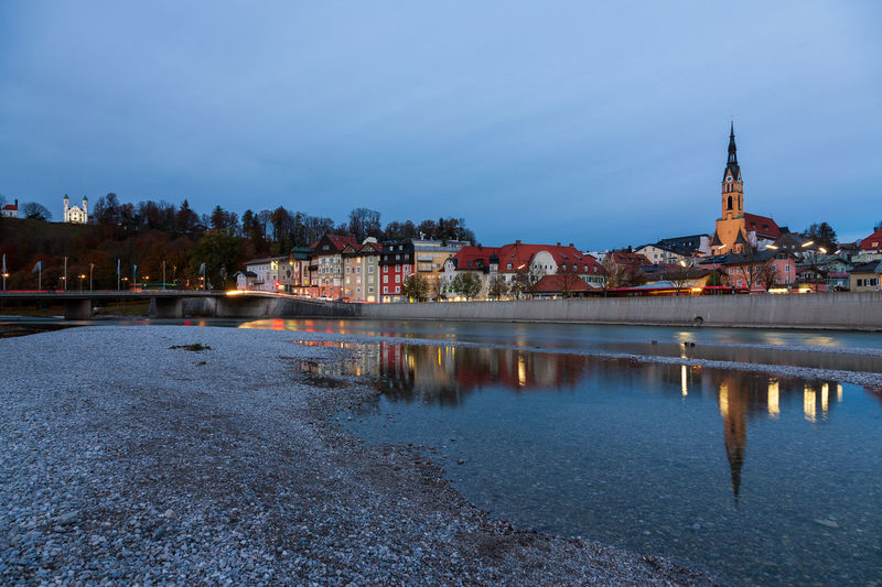 Cityscape Bad Tölz, Bavaria, Germany Bad Tölz Bavaria Germany River Isar Isar Isar River Architecture Building Exterior Built Structure Water Sky Building City Reflection Religion Spirituality Nature Place Of Worship Waterfront Illuminated Belief River No People Dusk Outdoors Cityscape
